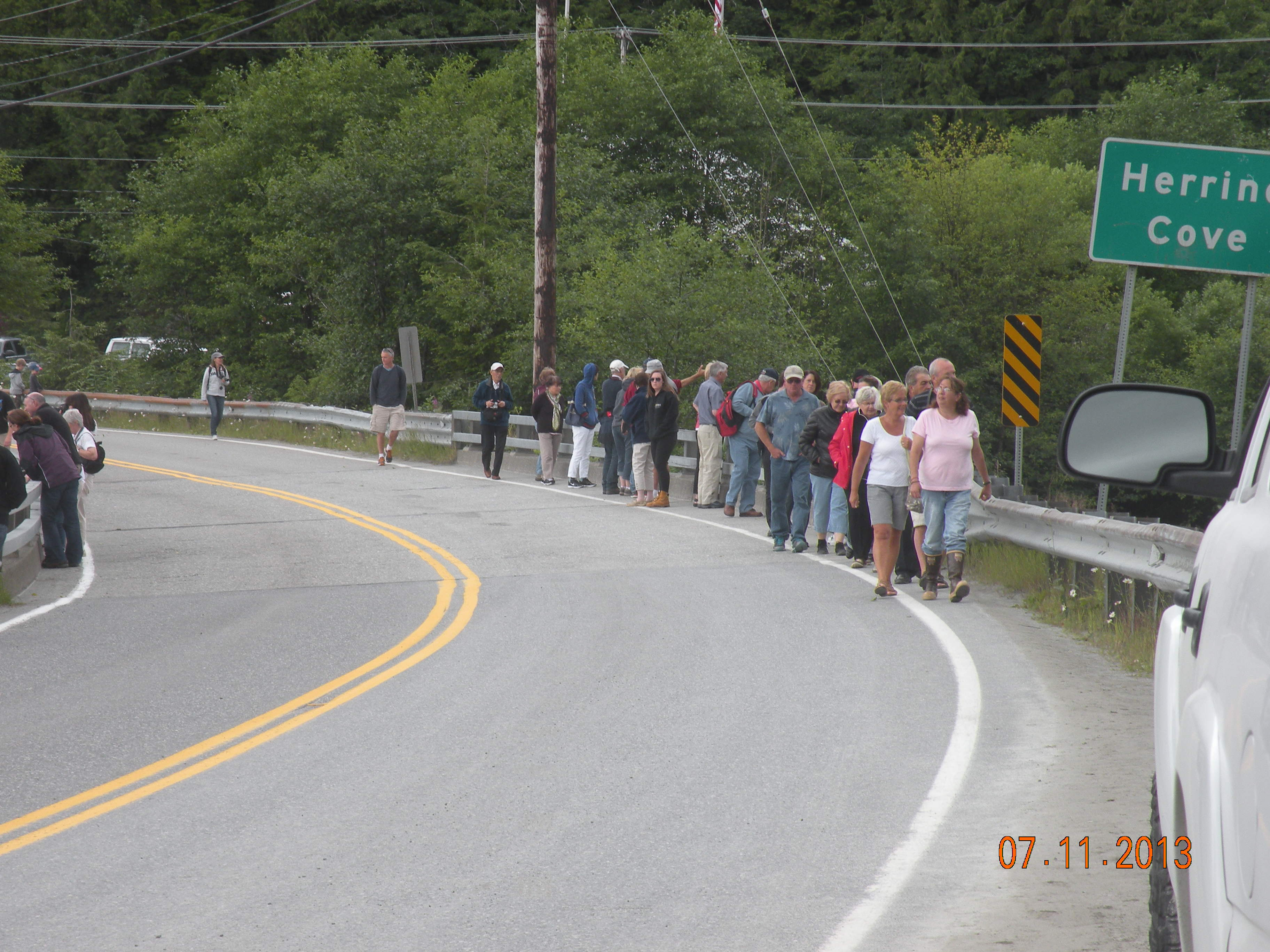 Pedestrians on the bridge at Herring Cove